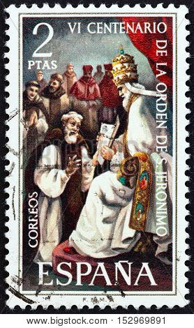 SPAIN - CIRCA 1973: A stamp printed in Spain issued for the 600th anniversary of the founding of the order of St. Jerome shows Pope Gregory XI receiving St. Jerome's petition, circa 1973.