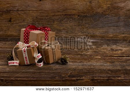 Carton handmade gift boxes on wooden background, copy space