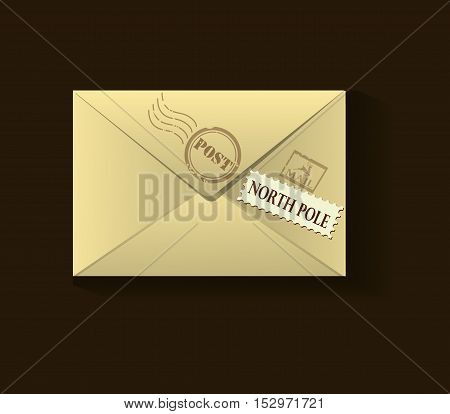 beige xmas envelope with postage stamps on brown background