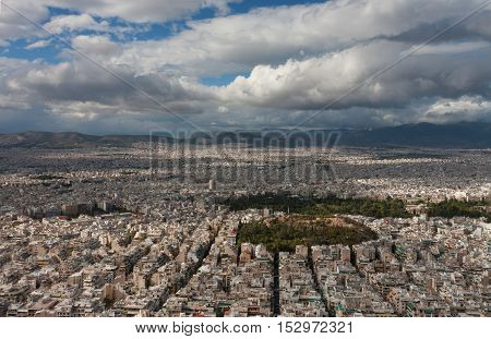 Aerial view of Athens from mount Lycabettus public park Pedion Areos surrounded by buildings.