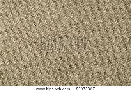 Linen fabric background with visible texture. Horizontal photo taken from above, top view with copy space for packaging, text and other web or print design elements.