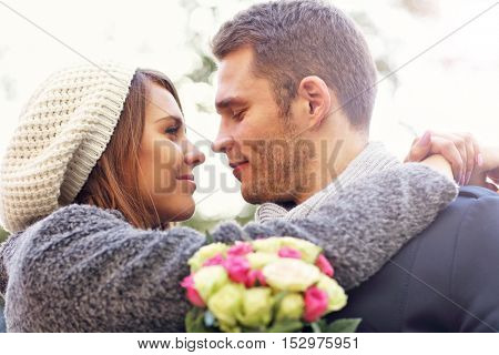 Picture of young couple kissing in the park