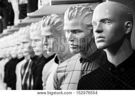 Mannequins in the department of menswear. Sale.
