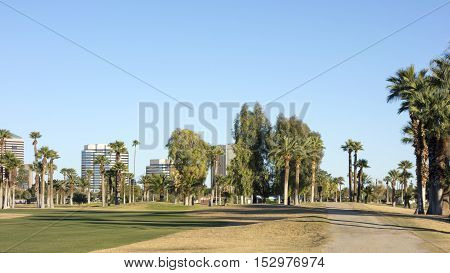A dirt road from Encanto park to downtown of Phoenix Arizona ; Copy space in clear blue sky