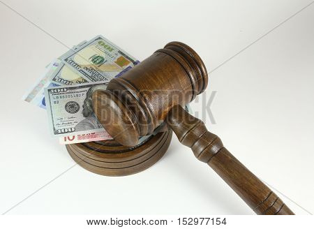 Auction Or Trial Concept With Auctioneers  Judges Gavel And Scattered Money Heap On Wooden Table, Cl