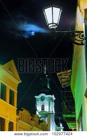 Old European church in a full moon night