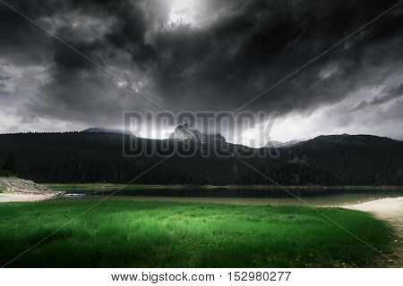 High Mountain And Lake At Cloudy Daytime. Beautiful Nature Landscape