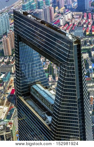 SHANGHAI, CHINA - SEPTEMBER 23, 2016 Looking Down on Black Shanghai World Financial Center Skyscraper Reflections Cityscape Liujiashui Financial District Shanghai China.