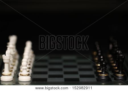 Chess pieces arranged on a chess board