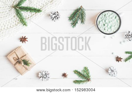 Christmas composition. Hot chocolate christmas gift knitted blanket pine cones fir branches. Flat lay top view