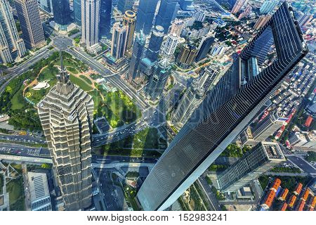 SHANGHAI, CHINA - SEPTEMBER 23, 2016 Looking Down on Black Shanghai World Financial Center SkyscraperJin Mao Tower Cityscape Liujiashui Financial District Shanghai China.