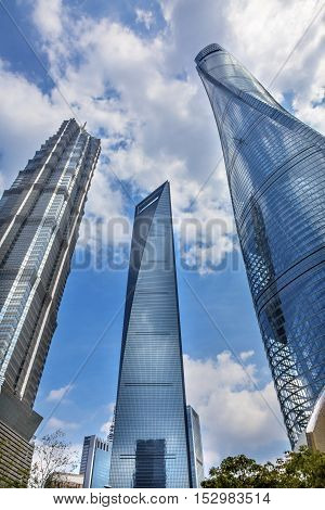 SHANGHAI, CHINA - SEPTEMBER 23, 2016 Three Skyscrapers Reflections Make Patterns and Designs Liujiashui Financial District Shanghai China. Shanghai Tower Shanghai World Financial Center and Jin Mao Tower