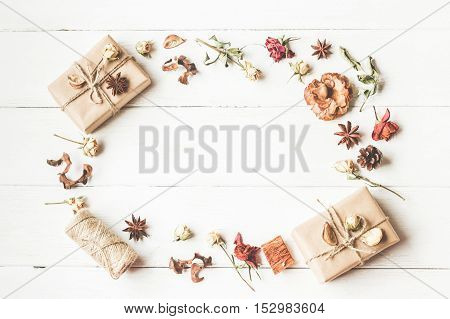 Autumn composition. Frame with gift autumn leaves anise stars dried flowers. Top view flat lay