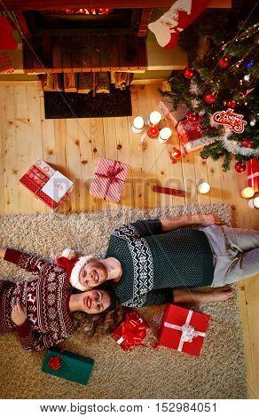 Couple enjoying on Christmas holiday in decorated house