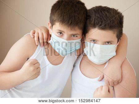 two positive boy in medical masks hug
