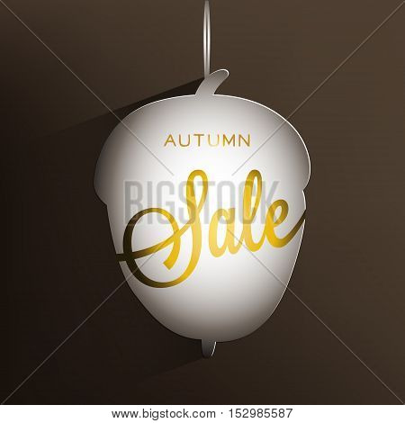 Autumn card. Brown background with paper white acorn and golden inscription Sale. Vector illustration.
