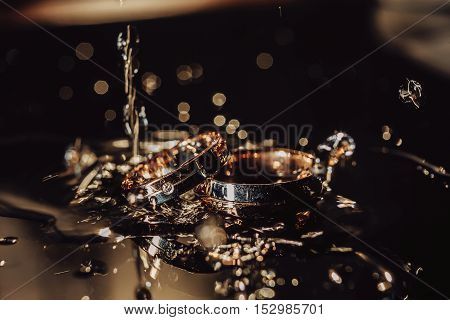 Wedding Rings Sinking in Water with Water Bubbles, Wedding details