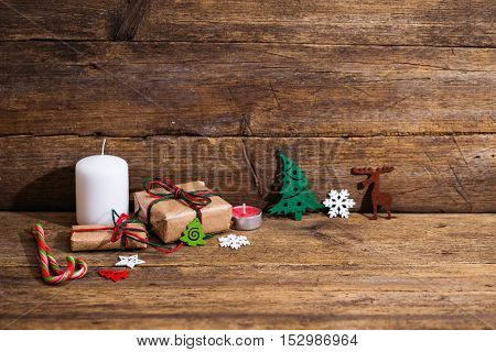 Seasonal Rustic Christmas Border Composed Of Decorative Gifts, Ornaments Over A Wooden Background Wi