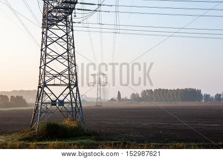 on a pasture in Germany there is a high voltage pole