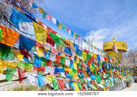 Buddhist prayer flags the holy traditional flag along tide to Pagoda in the Temple at Shangrila old town China.