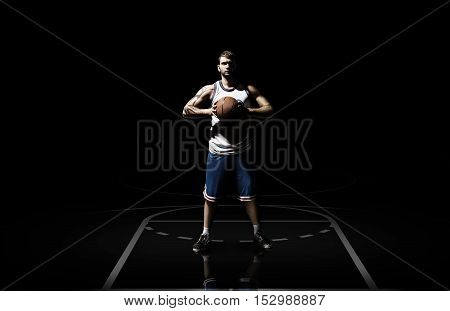 Caucasian basketball player in action with ball isolated on black background