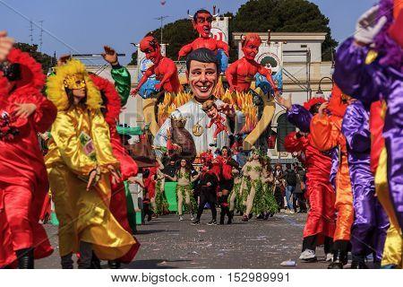Putignano, Apulia, Italy - February 15, 2015: Carnival floats, giant paper mache. Giants italian politicians: Matteo Renzi. Carnival costume.