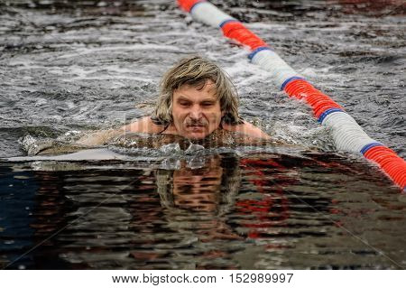 Tyumen, Russia - February 5, 2005: The club of winter swimming holds competitions in the 25 meters ice-hole