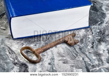 Antique iron skeleton key with large blue book with room for your type.