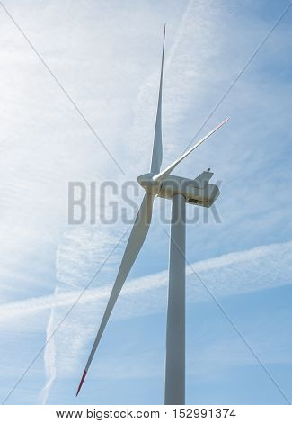 Wind turbine on blue sky whit clouds