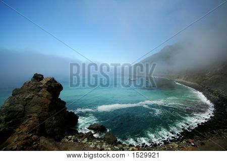 Rocky Beach With Fog