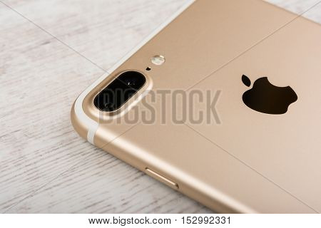 BURGAS, BULGARIA - OCTOBER 22, 2016: New Apple iPhone 7 Plus Gold on white background, back side, illustrative editorial.