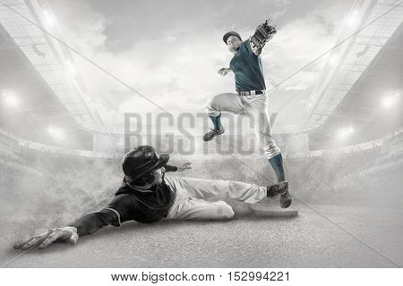 Baseball players in action on the stadium.