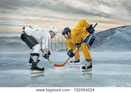 Ice hockey playersbefore action on the ice around mountains