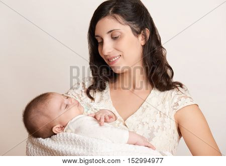 mother with sleeping baby portrait, happy maternity concept
