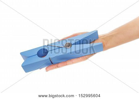 Large clothes pin in his hand on a white background.