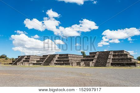 Three of the twelve small pyramids surrounding the Plaza of the Moon in front of the Pyramid of the Moon in San Juan Teotihuacan Mexico. The structures are fron the period before 200 AD.