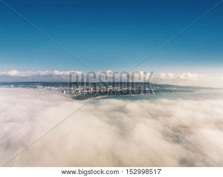 Flying above the clouds at sunrise with drone