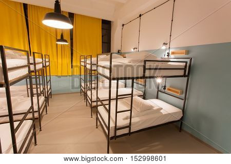 TBILISI, GEORGIA - OCT 8, 2016: Clean bedroom without people inside a hostel for youth tourists and students on 8 October, 2016. The annual number of tourists in Georgia reached 2300000 people