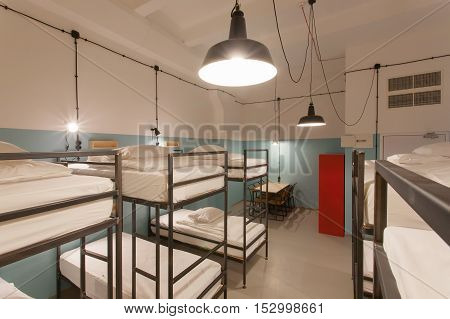 TBILISI, GEORGIA - OCT 8, 2016: Hostel bedroom interior with clean beds inside a dorm for lonely young tourists on 8 October, 2016. The annual number of tourists in Georgia reached 2300000 people