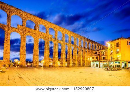 Segovia Spain town view at Plaza del Azoguejo and the ancient Roman aqueduct.