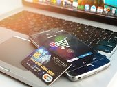 Mobile banking or online shopping concept. Mobile phone and credit card on laptop background. 3d ill poster
