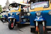 foto of workhorses  - Thai Motorised Three Wheel Transport at the market - JPG