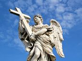 foto of angel-trumpet  - Ainceitn angel statue holding cross - JPG