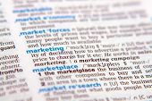 image of bartering  - Close up of the word marketing out of the dictionary - JPG