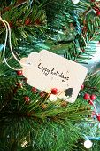 picture of happy holidays  - Happy Holidays card in a Christmas tree - JPG