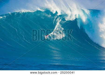 "MAUI, HI - MARCH 13: Professional surfer Francisco Porcella rides a giant wave at the legendary big wave surf break ""Jaws"" during one the largest swells of the winter March 13, 2011 in Maui, HI."