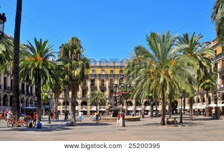 BARCELONA, SPAIN - AUGUST 16: Plaza Real on August 16, 2011 in Barcelona, Spain. The square, with lanterns designed by Gaudi and the Fountain of Three Graces in the center, has a lot of restaurants