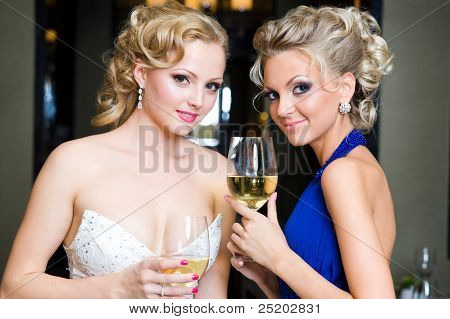 Bride And Her Bridesmaid In A Restaurant