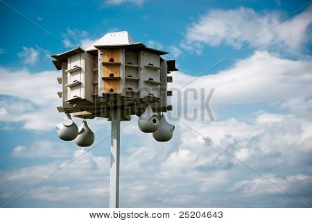 Large White Bird House Against Blue Sky