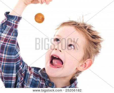 Close Up Of Young Boy Eating A Lollipop.